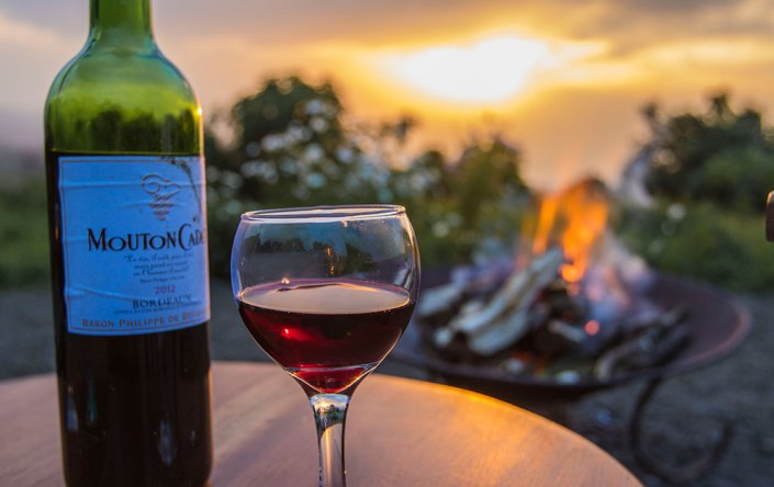 Bukima Camp - Sunset wine - campfire