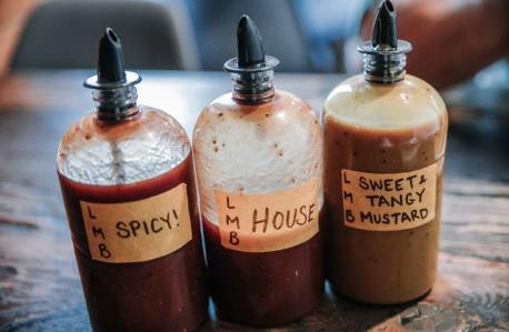 Three bottles of bbq sauce
