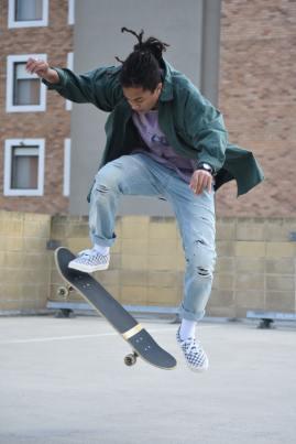 man pivoting on skateboard