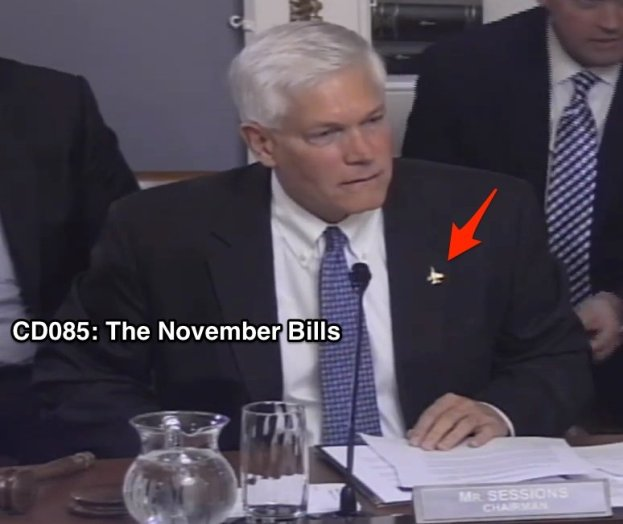 """Rep. Pete Sessions shows of his fighter jet pin, which reminds him of one of his favorite sayings: """"Peace through superior fire power."""" Creepy."""