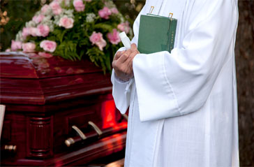 A pastor performing a funeral.