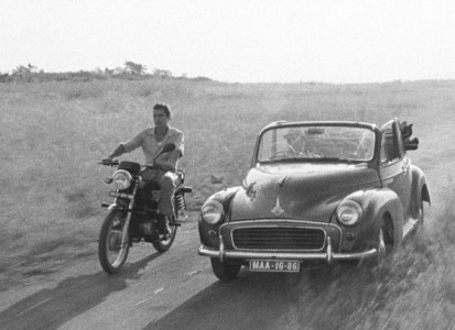 tabu-2012-004-speeding-motorboke-and-open-top-car