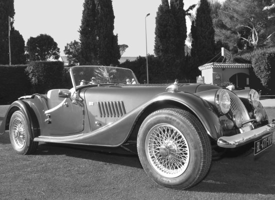 A black and white photo of a Morgan sports car.