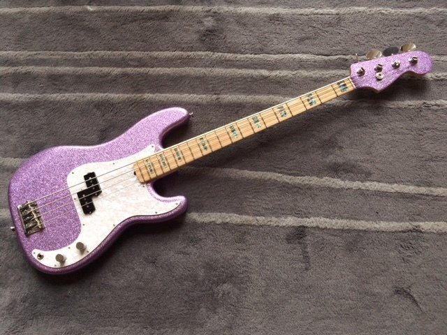 """As the low-end master for seminal band U2, Adam Clayton has been using Fender basses for decades. In partnership with Fender, Adam has co-designed a signature bass that brings his custom specs to the bass-playing public. The Adam Clayton Precision Bass features a custom maple """"C"""" shaped neck profile designed by Clayton for a smooth feel and instant playability. A solid Alder body on the Adam Clayton P Bass also gives this instrument impeccable tone for live performance, while a single Custom Shop 60's Single-Coil pick up is featured, delivering clean, low, fat tone when amplified."""