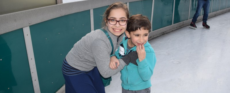 A young girl and boy at Friends@Home Day at Schenley Park Skating Rink