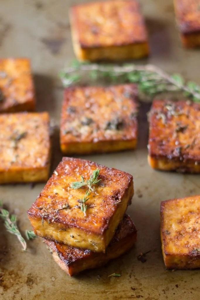 Savory Lemon & Herb Baked Tofu on a Distressed Baking Sheet