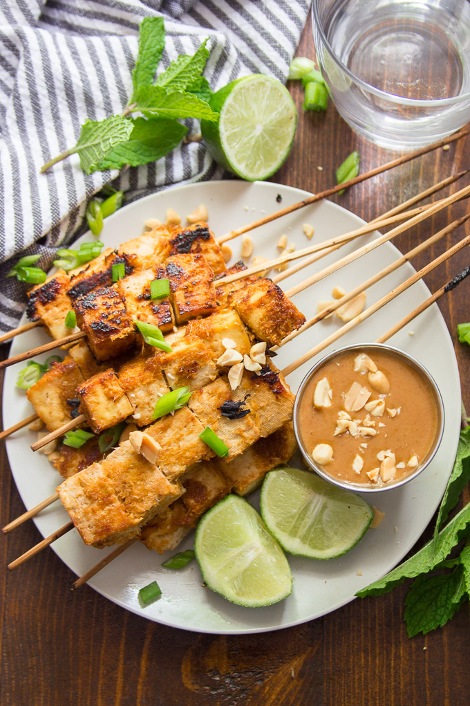 Tofu Satay on a Plate with Water Glass and Striped Napkin