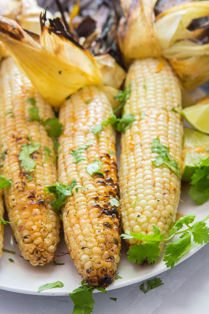 Three Ears of Mexican Grilled Corn on a Plate
