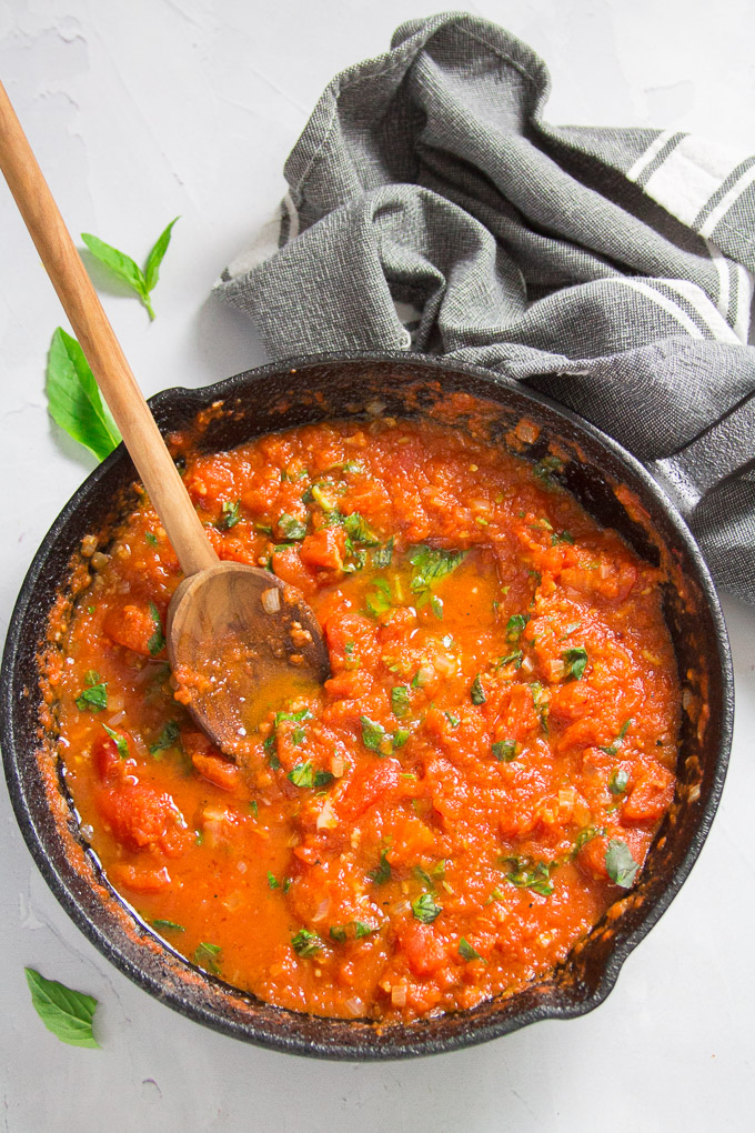 Skillet of Pomodoro Sauce with Wooden Spoon
