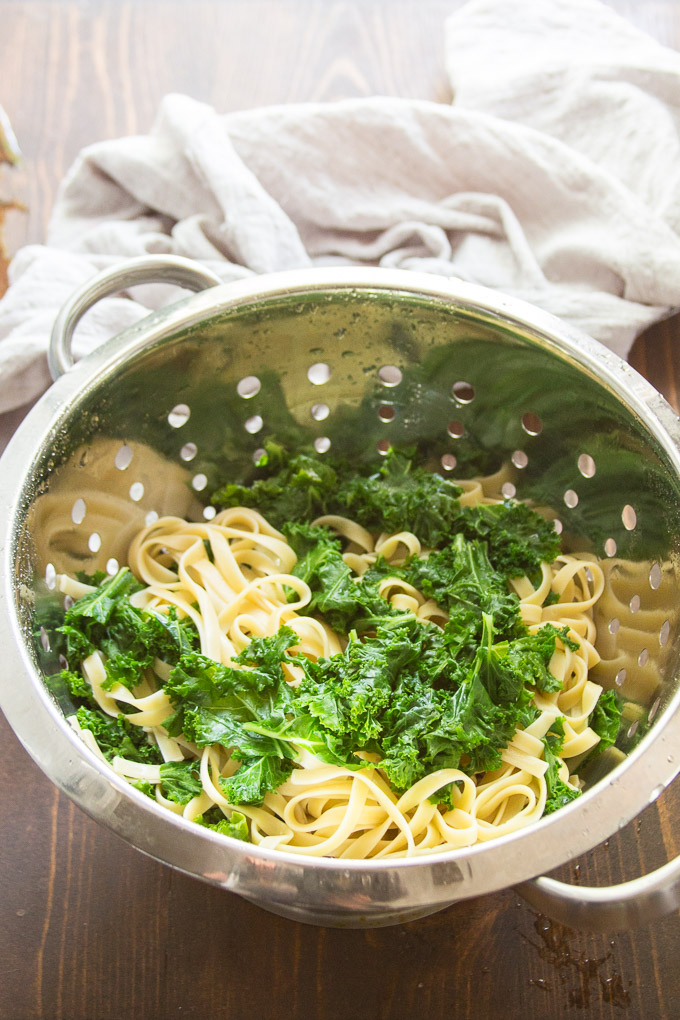 Pasta and Blanched Kale Draining in a Colander