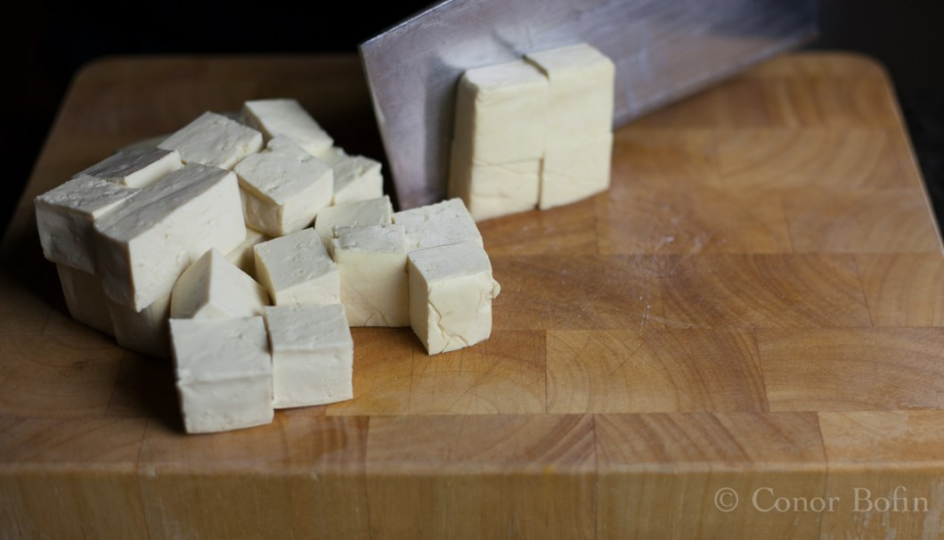 The tofu needs to be cut into cubes, big enough to pop into your mouth (even with numb lips).