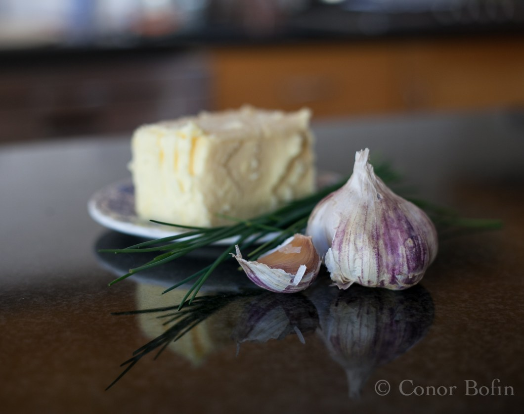 Garlic, chives and butter. The ingredients needed for the garlic and chive butter.