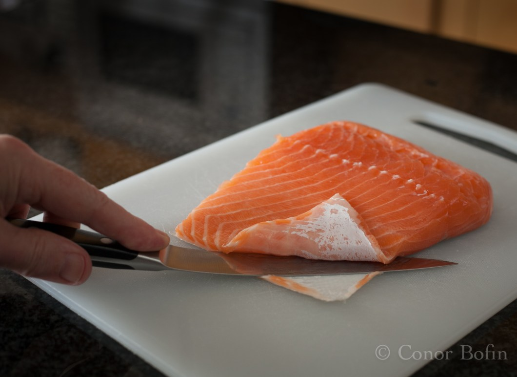 The salmon can be cut away from the skin more easily than the reverse.