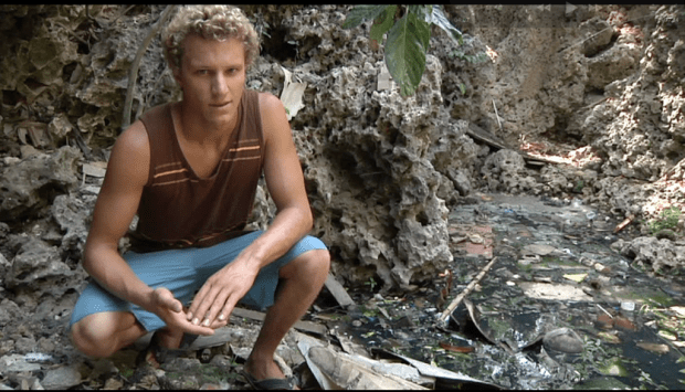 Kyle visiting a Septic Pit while on a Surf Trip