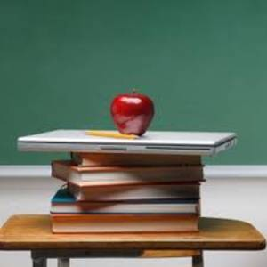 School books and an apple, common symbols of education