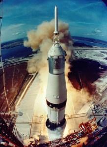 Apollo 11 lifts off.