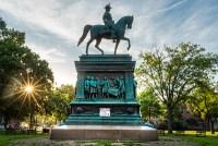 Defund the police sign at base of plinth of Logan Circle statue, Washington, D.C.