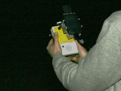 AnaBat acoustic detector. The attached PDA (like a little computer screen) lets us view incoming bat calls instantly. © MacKenzie Hall