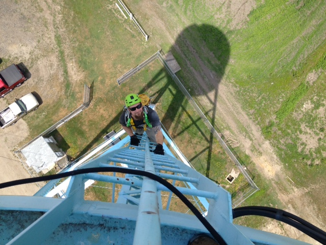 Ben Wurst climbs down the 150' water tower. Photo by John Heilferty/ENSP.