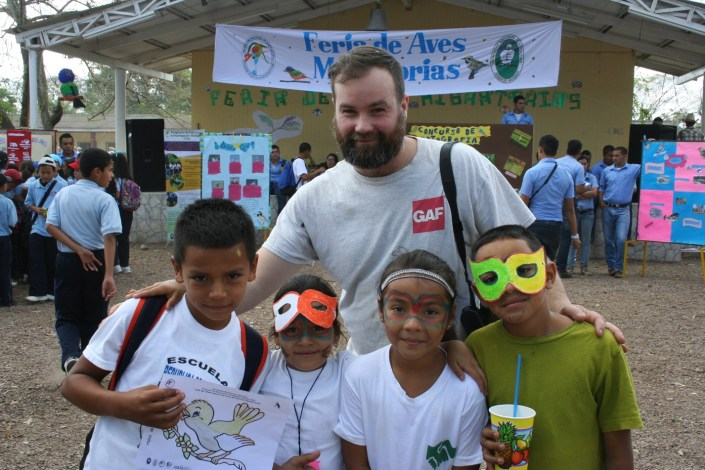 Jon Kauffman, Raptor Center Assistant Director of Penn State's Shaver's Creek poses with the elementary children at the festival. Photo by Kelly Triece