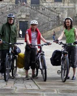 Reaching the cathedral of Santiago de Compostela after cycling 500km - John, Gem and Natasha Patten.