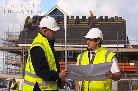 A06200187 Construction manager and Foreman looking at  Construction Photography
