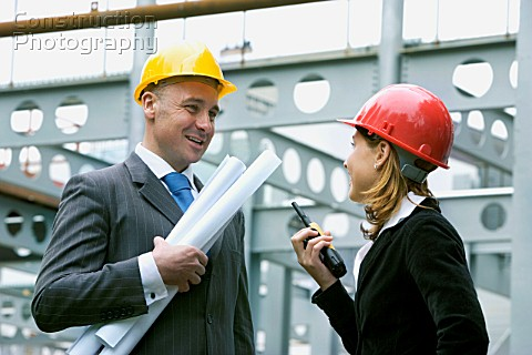 M00100043 Young woman and construction Manager on a co  Construction Photography