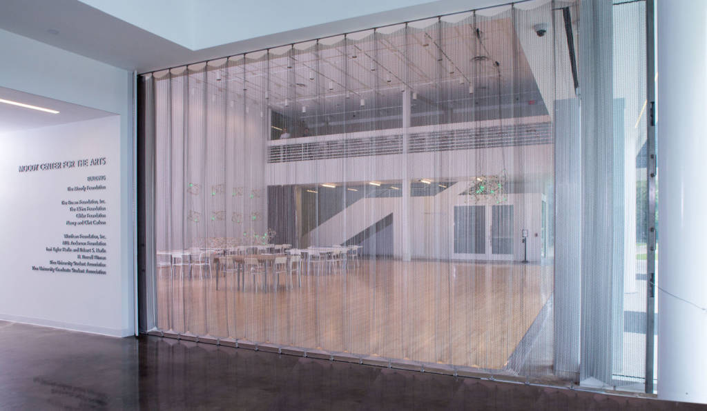 https www constructionspecifier com mesh curtain allows for an arts center with vision