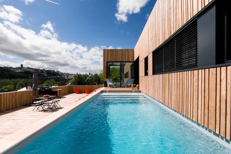 Maison en bois contemporaine avec piscine en toit terrasse  France  Construire Tendance