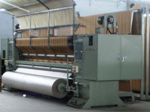 cut and loop tufting machine