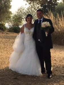 Smiling bride and groom in the Valley of Temples, Agrigento, Sicily