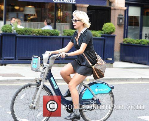 Pixie Lott spotted cycling on a 'Barclays Cycle