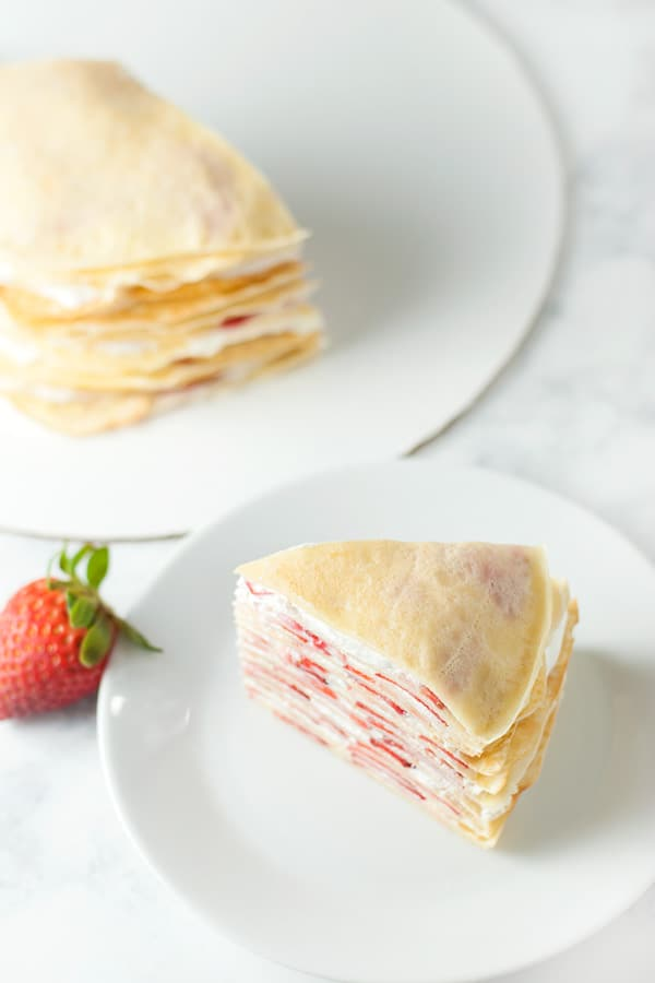 top view of sliced strawberry crepe cake.