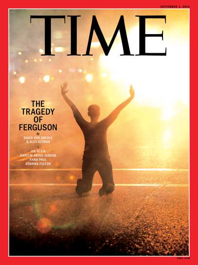 <em>Time</em> magazine use of 'hands up' pose to represent Ferguson protests. Original photograph by Scott Olson–Getty Images.