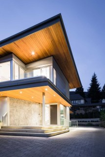 Butterfly Roof And Dramatic Lighting Give Home