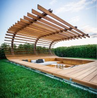This poolside sunken seating area was designed for an ...