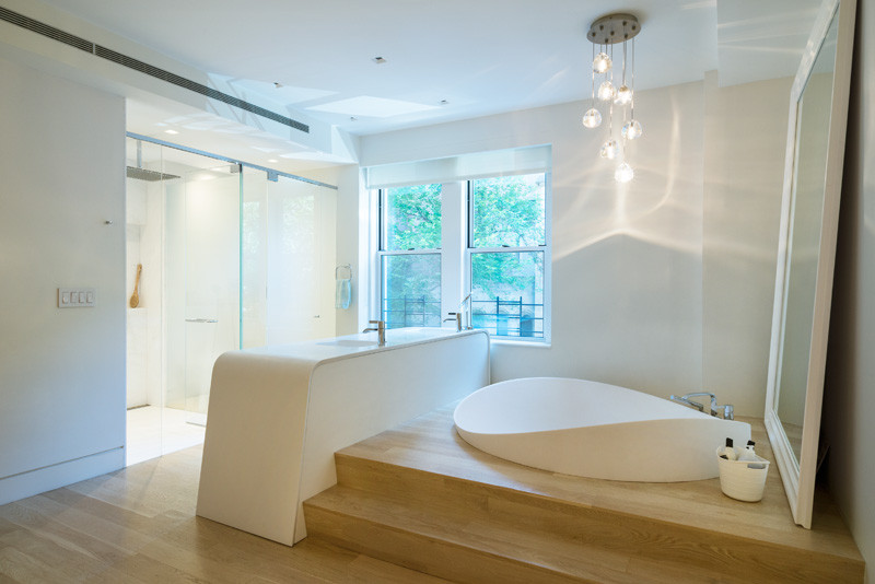 A sculptural bathtub was sunken into a raised platform in this New York apartment  CONTEMPORIST