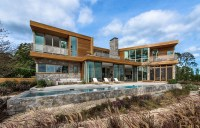 This wood and stone house overlooks the New York coastline ...