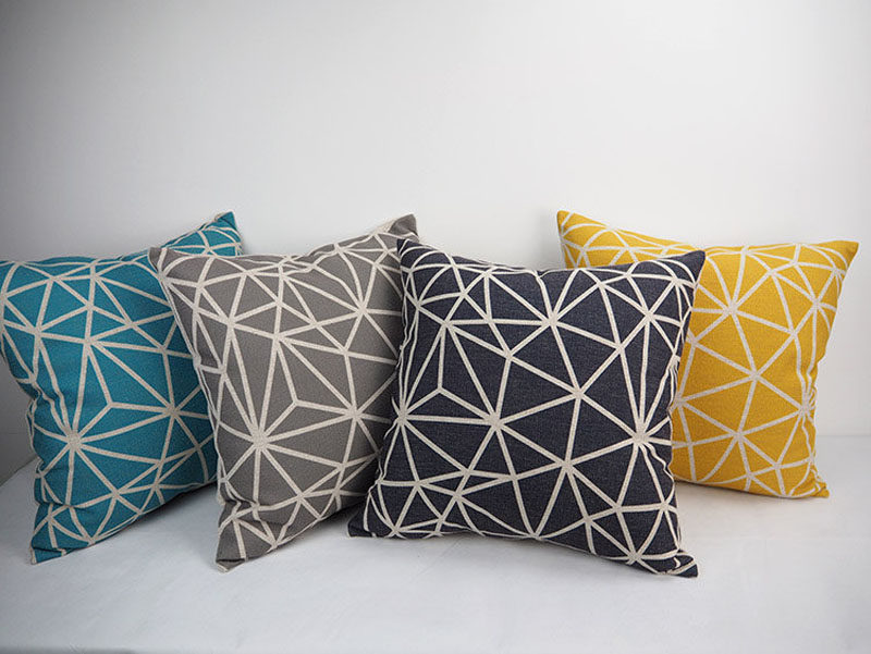 How To Make Your Balcony Awesome For Summer // Adding some geometric throw pillows is a great way to make your balcony cozier, and they can be another way to bring some color to the space.