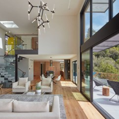 Open Plan Staircase In Living Room Sets Under 500 Dollars This New Home Lives On A Steep Hillside Just Outside Of San Down The Stairs You Re Greeted With Large Dining And Kitchen Area