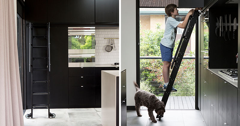 This Kitchen Has A Rolling Ladder To Reach The Upper Cabinets