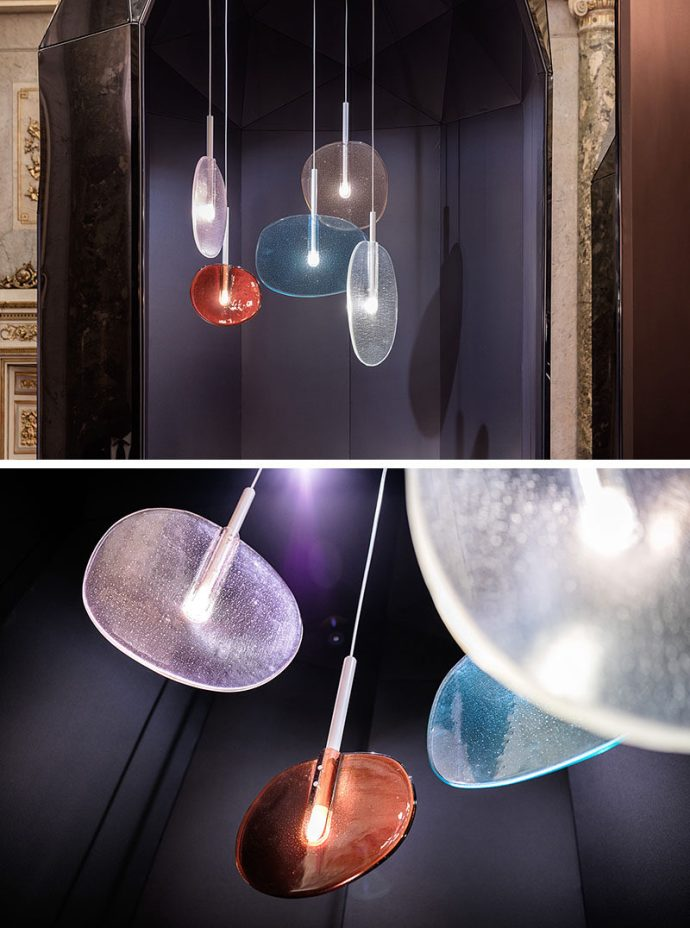 The Lollipop Collection, made up of a floor lamp, table lamp and pendant lamps, has been designed as a playful reminder of what it is like to look through a glass bottle into the sun, or when you hold a lollipop up to the light.