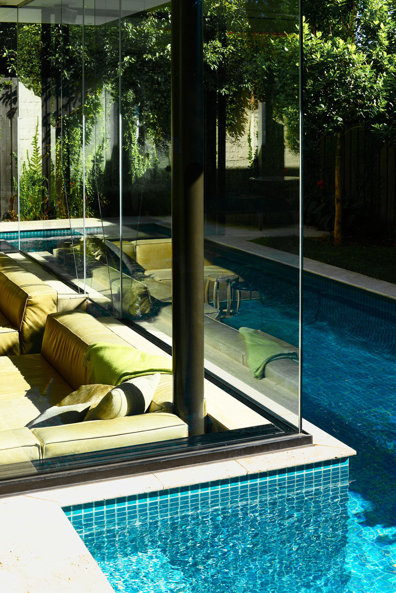 This house has a sunken living room so people can be at the same level as those in the swimming