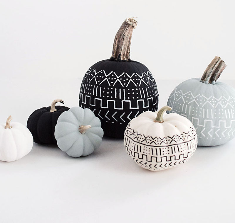 13 Modern DIY Halloween Pumpkin Ideas // Create a mud cloth inspired pumpkin with some chalk paint and paint pen to include the popular pattern in your fall decor.