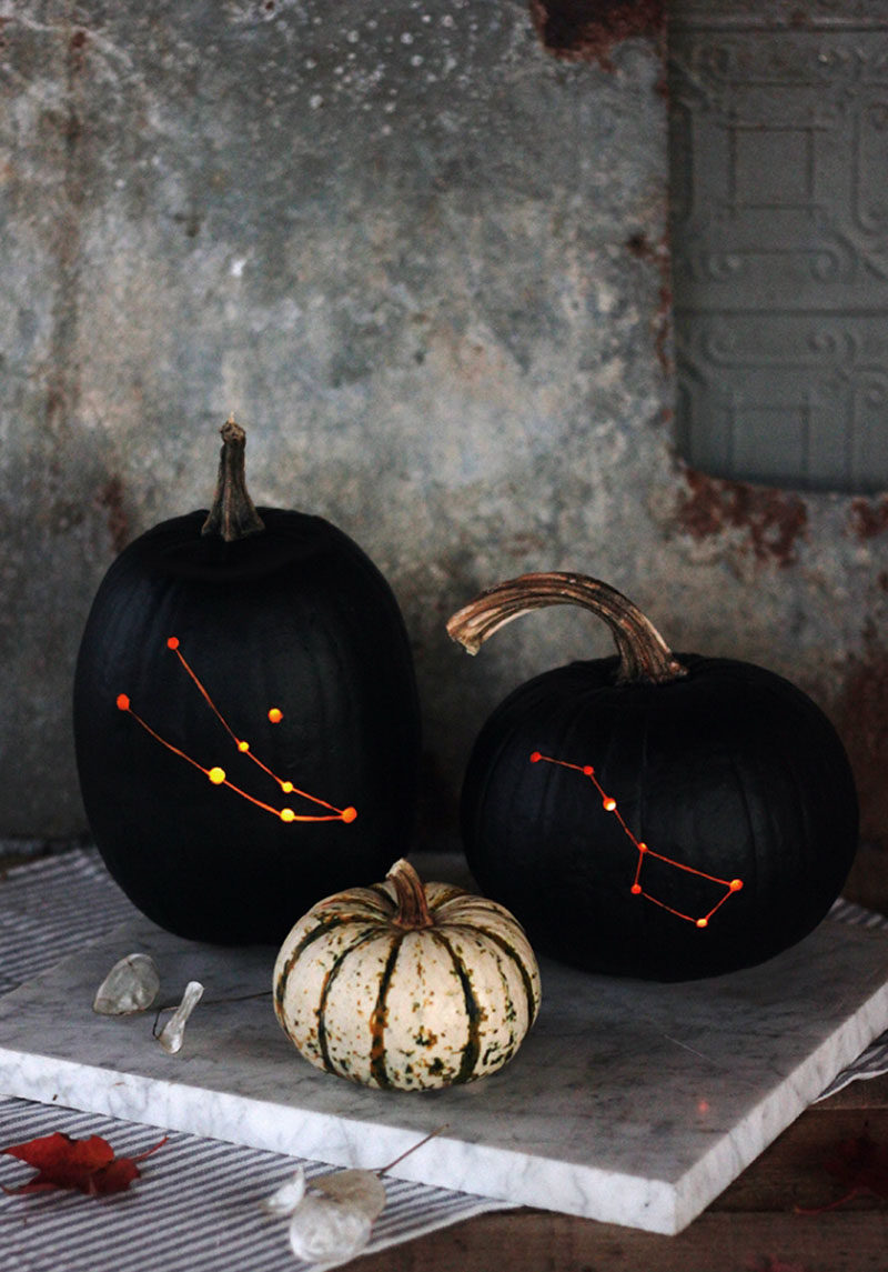 13 Modern DIY No-Carve Halloween Pumpkin Ideas // Align the stars with these constellation pumpkins made with a drill, black paint, and a chisel.