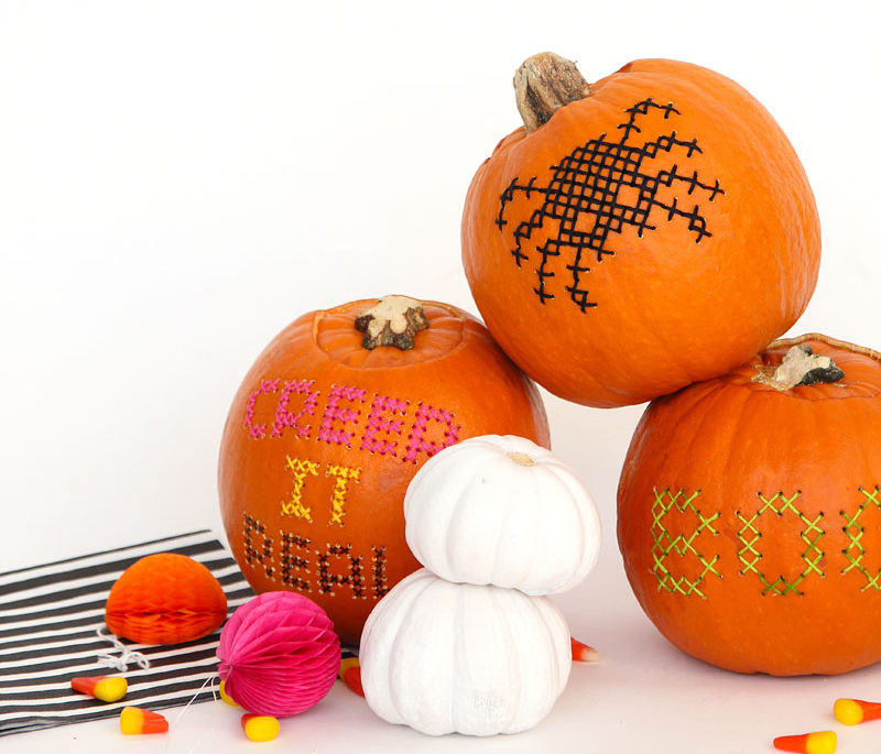 13 Modern DIY Halloween Pumpkin Ideas // You probably never thought you'd take a needle and thread to a pumpkin, but to make these cross stitch pumpkins they're the main materials you'll need.