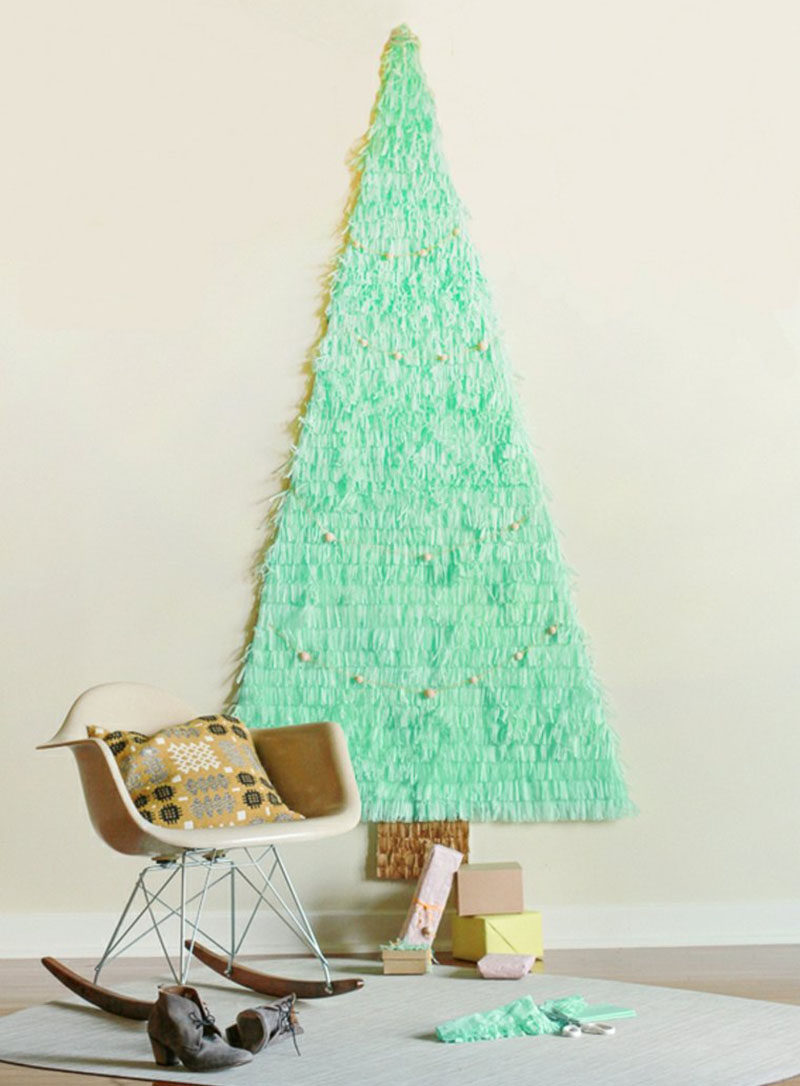 Christmas Decor Ideas - 14 DIY Alternative Modern Christmas Trees // All you need to make this simple space saving tree is some tissue paper, poster board, tape and scissors.