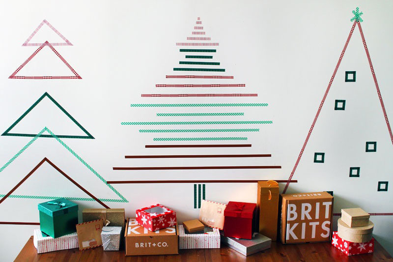 Christmas Decor Ideas - 14 DIY Alternative Modern Christmas Trees // Simple trees made from strips of washi tape are an easy way to create Christmas tree shapes on your walls that can be as simple or as elaborate as you like.