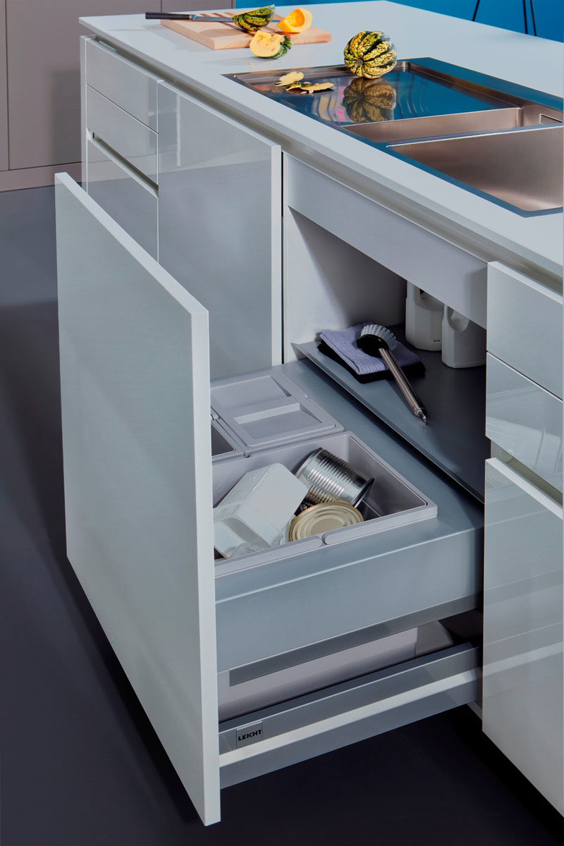 blum kitchen bins 2 chair table set design idea hide pull out trash in your cabinetry the handles