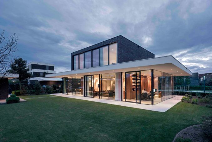 Architecture firm Powerhouse Company, have designed this dark brick and glass contemporary home for a family with two children in the Netherlands.